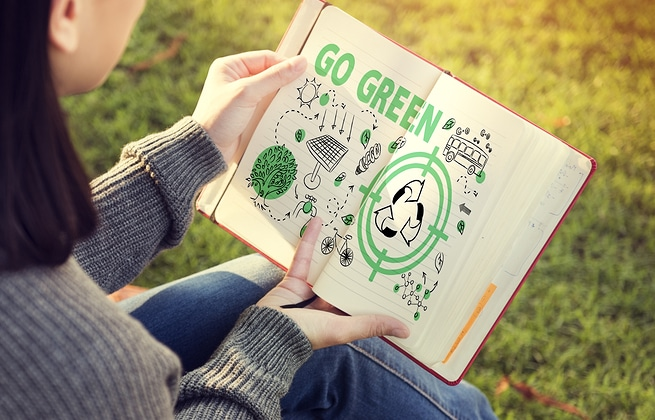 Woman reading book about going green